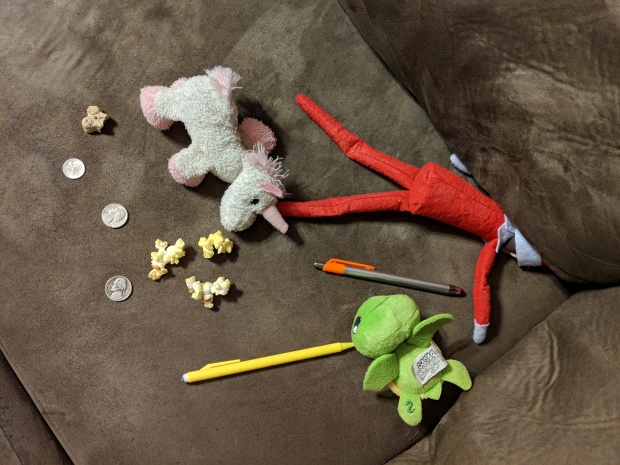 Elf finding odd things in between the couch cushions.